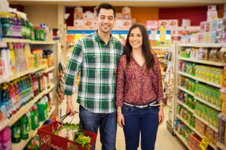 Photo for Happy couple buying some groceries - Royalty Free Image