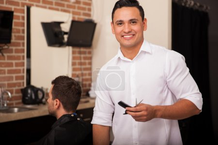 Young Latin barber at work