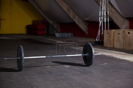 Photo for Cross-training gym with a barbell and weights ready for a workout - Royalty Free Image