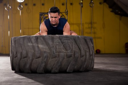 Determined to lift up a tire