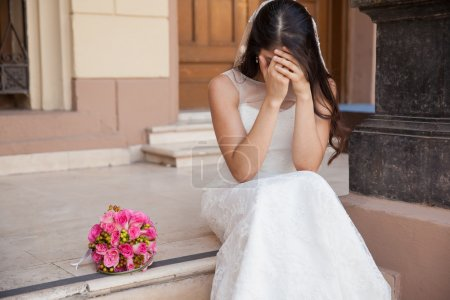Bride crying outside church