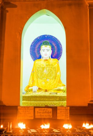 Photo for Statues of deities in the Buddhist temple. Shwedagon Pagoda was built in the 11th century - Royalty Free Image