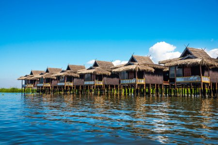 Ancient houses and their reflection in the water on the Inle Lake, Myanmar