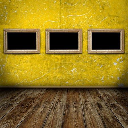Empty frames in vintage room