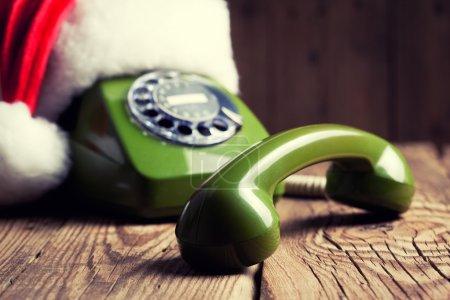 Vintage phone with Santa's hat