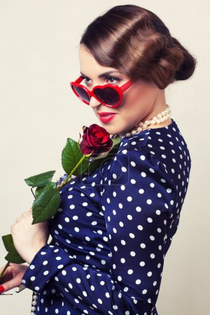 Retro woman with red rose and glasses