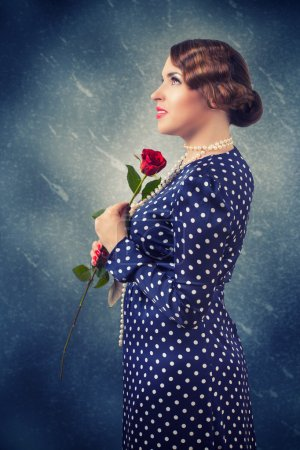 Photo for Portrait of retro woman with red rose - Royalty Free Image