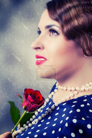 retro woman with red rose