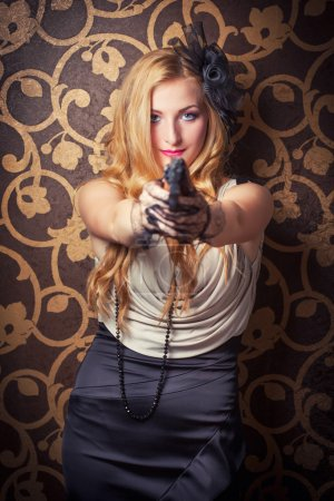 Woman holding  revolver