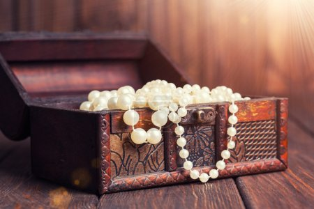 Chest with pearl necklaces