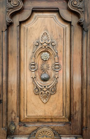 Old door of wood with patterns carved on it.