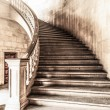Marble winding staircase with high solid handrails...