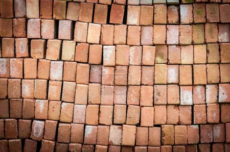 Photo for New red brick pavers stacked in rows like wall. Store of bricks ready for building or sale. Construction materials and outdoor storage. - Royalty Free Image