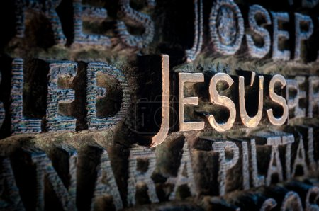 Name of Jesus written on the wall in cathedral.