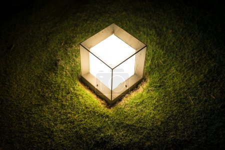 Lighting cube lantern on grass