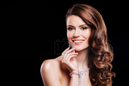 portrait of a beautiful brunette girl with luxury accessories. happy fashion model