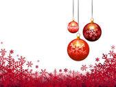 Three christmas balls on snow flakes background