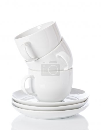 Photo for Stack of white china cups and saucers on a white background - Royalty Free Image