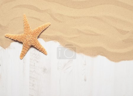 Photo for Sand on wooden decking with starfish - Royalty Free Image