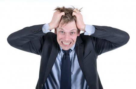 Stressed businessman pulling his hair