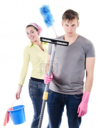 Man and woman cleaning the house