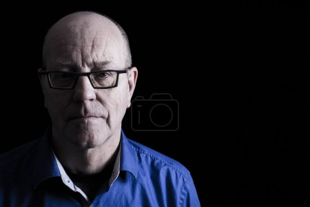 Photo for Old man with glasses face close up on black background. - Royalty Free Image