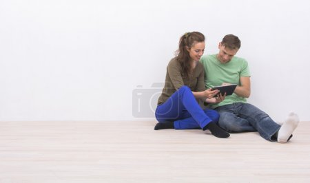 Young couple using tablet pc