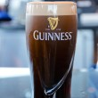 Постер, плакат: Pint of beer served at popular Guinness Brewery