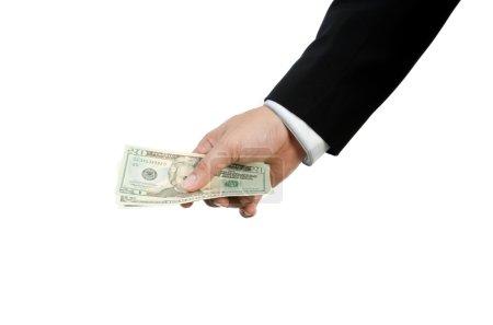 Hand holding US dollars isolated on white background
