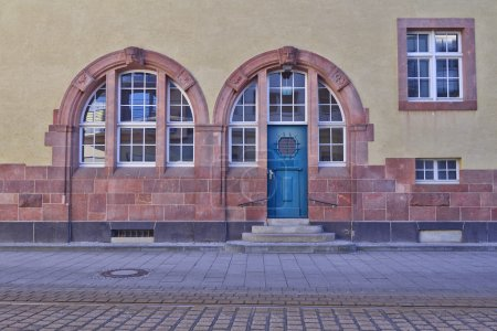 Entrance with arched blue door and windows