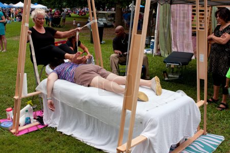 Woman Gets Ashiatsu Barefoot Massage At Summer Festival