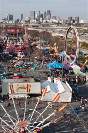 Elevated View Of Urban Fairgrounds Shows Atlanta City Skyline