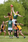 Men Jump For Ball In Amateur Australian Rules Football Game