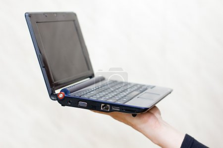 The laptop on a hand of the businessman