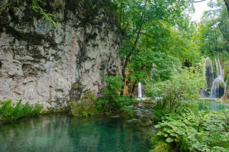 Nature with waterfall in a forest in Croatia, transparent river