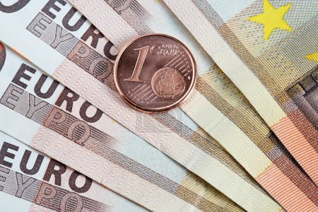 Photo for Photo of detail of various Euro banknotes and coins - Royalty Free Image