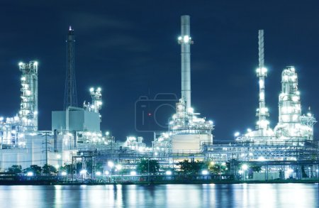 Photo for Closed up Oil refinery factory with reflection on the river. - Royalty Free Image