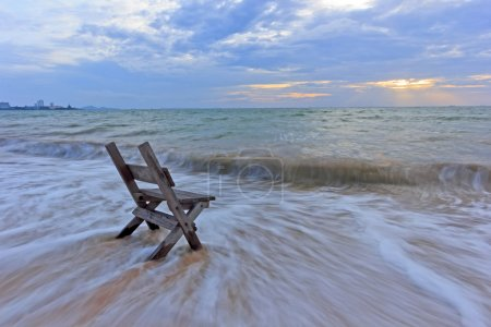 Photo for Chair on the sea sand with long speed shutter at sunset period... lonely and waiting - Royalty Free Image