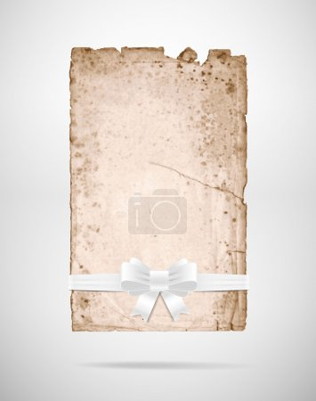 Vector very old rusty torn paper sheet with white silky ribbon bow