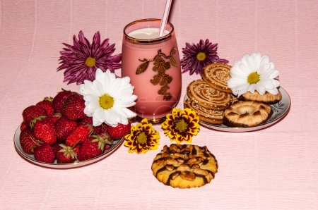 Strawberries milkshake and cookies and flower of C...