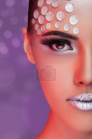 Woman fashion rhinestone make up on blurry background