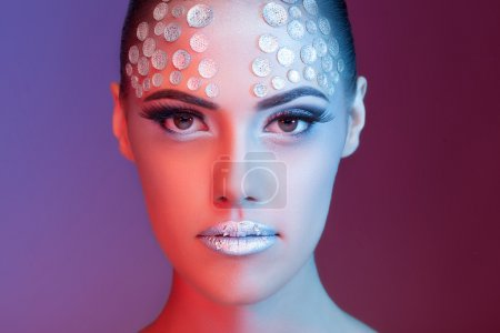 Artistic fashion rhinestone make up on beautiful woman
