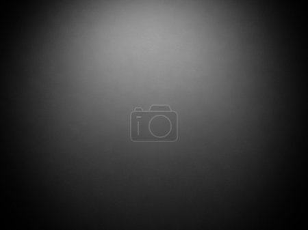 Abstract vintage grunge dark gray background with black vignette frame on border and center spotlight
