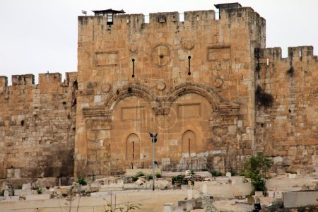 Photo for The Golden Gate of Jerusalem, or Sha'ar Harachamim, is the oldest of the current gates in Jerusalem's Old City Walls. Jews used to pray for mercy at the gate, hence the name Sha'ar Harachamim, the Gate of Mercy. In Arabic, it is known as the Gate of - Royalty Free Image