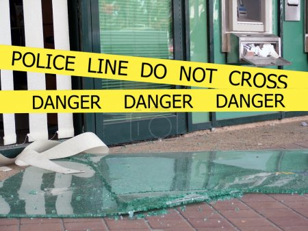 Police line do not cross sign tape on damaged by explosion building background