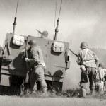 Soldiers in World War II era battle...