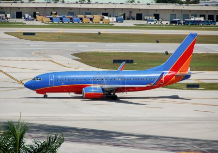 Photo for FORT LAUDERDALE, FL - MAY 10: A Southwest Boeing 737 taxis on May 10, 2012 in Fort Lauderdale, FL. Southwest is the world's second largest airline with 708 planes and 106.2 million passengers in 2010. - Royalty Free Image