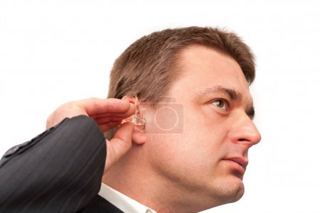 Putting on a hearing aid