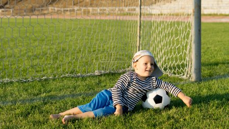 Barefoot youngster with soccer ball