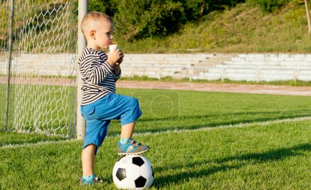 Small boy kicking a soccer ball